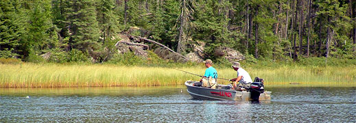 Fishing around weed beds for trophy northern in Canada